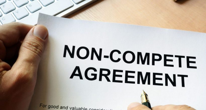 83442717 - man is signing non compete agreement